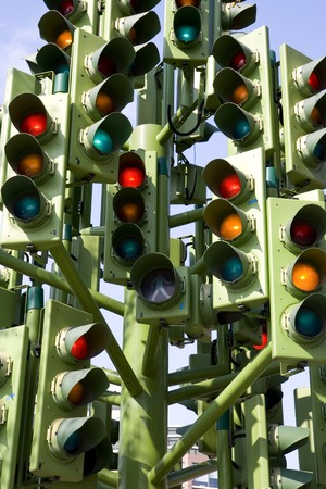 Multiple traffic lights on green amber and red photo