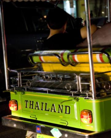 Tuk-tuk in bangkok with thailand sign on rear Stock Photo - 1406370