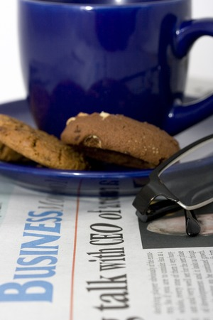 Business section of newspaper and cup of coffee Stock Photo - 1438709