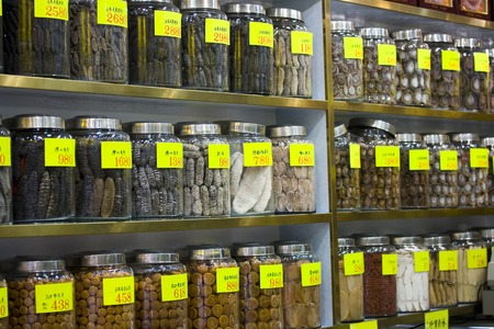 Rows of chinese herbal medicines on shelves Stock Photo - 1449625