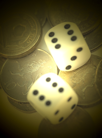 dice and coins with a white spotlight Stock Photo - 1449616