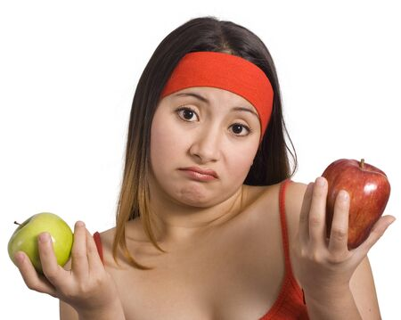 sporty woman cannot choose between green and red apple photo