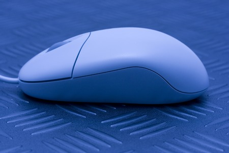 white computer mouse on a metallic patterned surface Stock Photo - 1476921