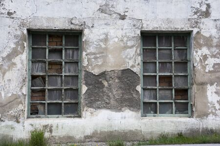 flaky: old derelict windows with flaky paint and broken windows Stock Photo