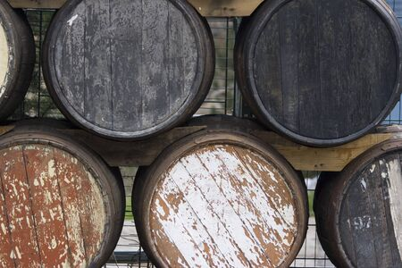 old wine barrels in a storage rack Stock Photo - 1528371