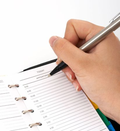 working week: writing on a personal organizer over a white background