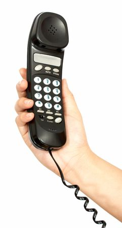 a hand holding a black telephone handset over a white background Stock Photo - 2539631
