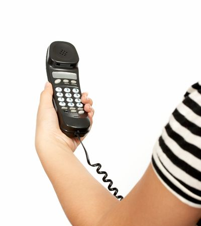 A hand holding a  telephone handset over a white background Stock Photo - 2539645