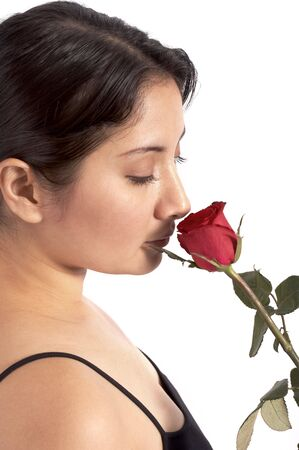 younglady: a young woman smelling a red rose over a white background