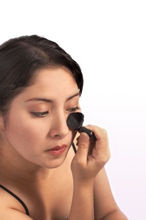 younglady: a young woman applying make-up over a white background
