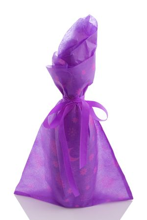 redwine: gift wrapped wine bottle over a white background