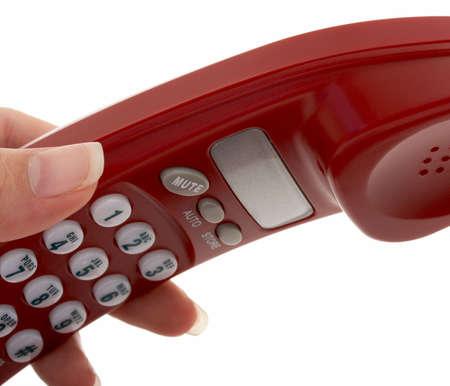 repondre au telephone: part ramasser un t�l�phone sur un fond blanc