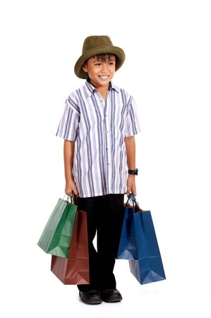 happy young boy on a shopping spree photo