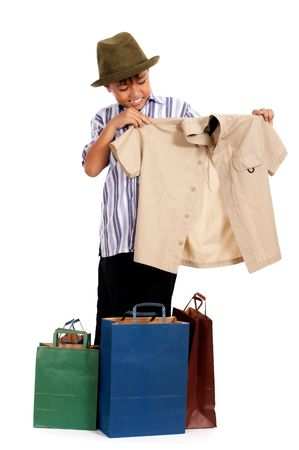 young man holding polo shirt  and shopping bag photo