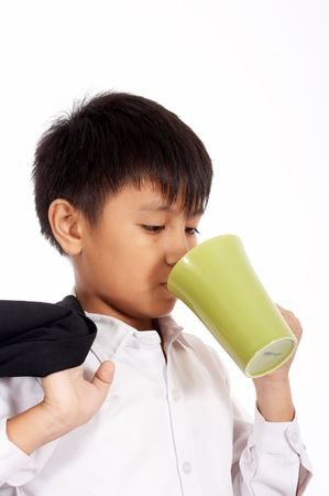 young office boy is drinking on a white background Stock Photo - 2615320