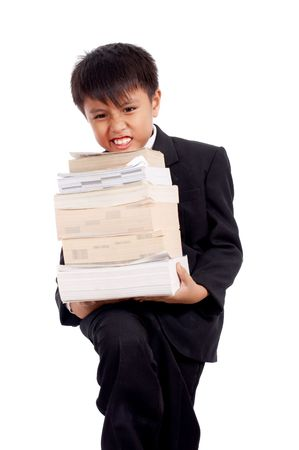handsome boy in black suit holding a stack of books photo