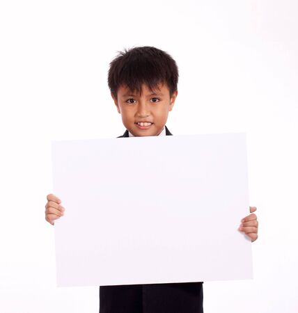 placard: nine year old boy holding a white blank board