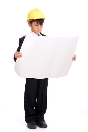 young male engineer analyzing a floor plan Stock Photo - 2887263