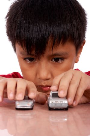 nine year old boy playing toy car photo