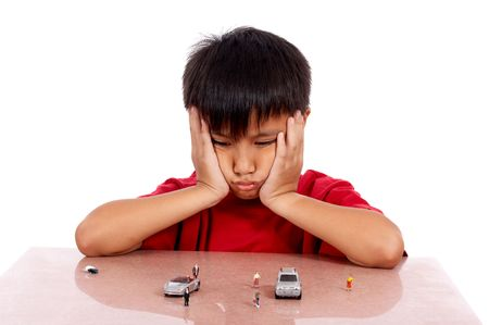 little boy imagining he is driving the toy car Stock Photo