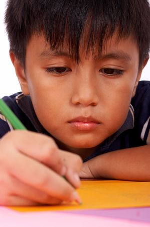 sad young boy studying his lesson seriously photo