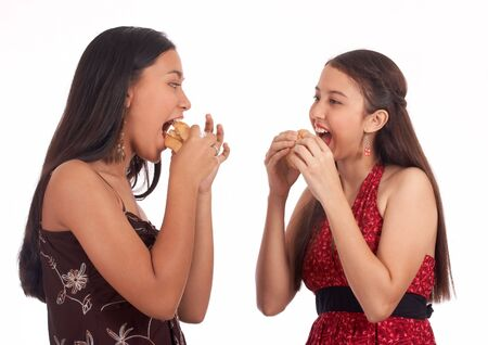 acquaintance: Two girls eating a healthy chicken sandwich