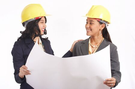 female architects working on their floor plan Stock Photo - 2887512