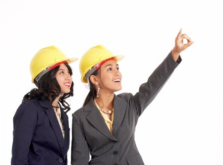 two professional draftswoman looking up and pointing  Stock Photo - 2887278