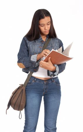 studious: studious female student reading her notes before going to school