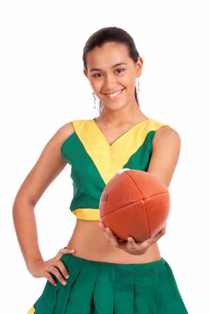 pom: Cheerleader smiling while showing a rugby ball Stock Photo