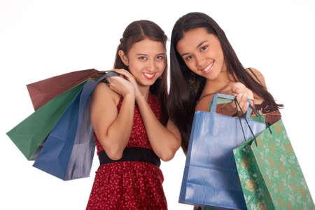Beautiful shopping girls holding lots of shopping bags photo