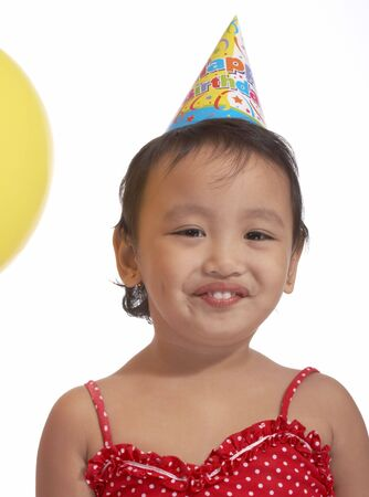 asian preteen: girl with party hat on red top