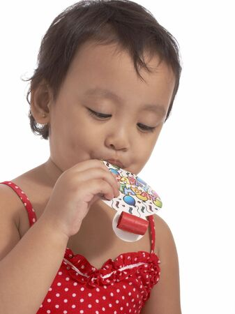 party popper: attractive little girl holding a party popper