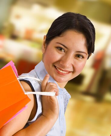 Woman In A Shopping Mall Carrying A Shopping Bag Stock Photo - 9597528