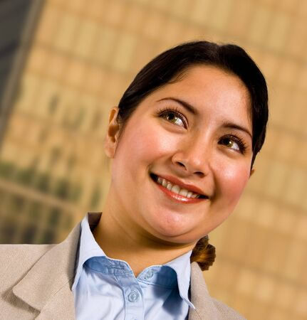 Smiling Business Woman Standing Outsite Her Company Headquarters Stock Photo - 9631631
