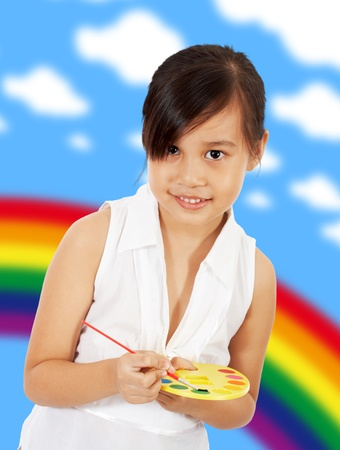 Young Artistic Girl With A Paint Set In Her Playrorm  photo