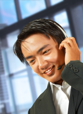 bussiness man: Customer Service Helpdesk Operator Talking To A Customer And Wearing A Headset Stock Photo
