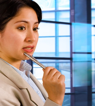 Business Woman Thinking About Company Plans In Her Office Stock Photo - 9782526