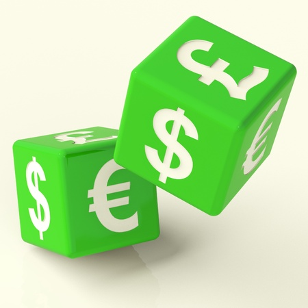 money exchange: Currency Signs On Green Dice As A Symbol Of Foreign Exchange Stock Photo