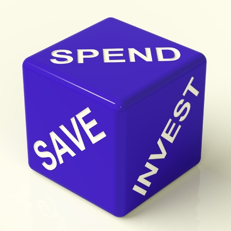 investing: Save Spend Invest Blue Dice Showing Financial Choices Stock Photo