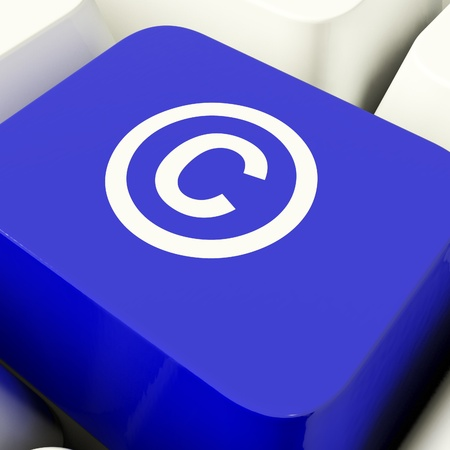 Copyright Computer Key In Blue Showing Patent Or Trademarks photo