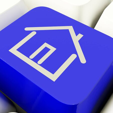 House Symbol Computer Key In Blue Showing Real Estate Or Rental Stock Photo - 11947792