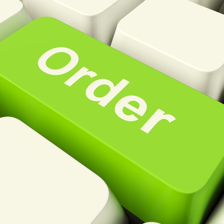 order online: Order Computer Key In Green Showing Online Purchases And Shopping