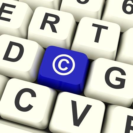 originator: Copyright Blue Computer Key Showing Patent Or Trademarks