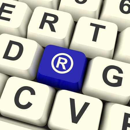 registered: Registered Computer Blue Key Showing Patent Or Trademarks Stock Photo