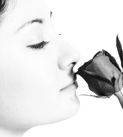 Girl Smelling A Valentines Rose From Her Boyfriend photo