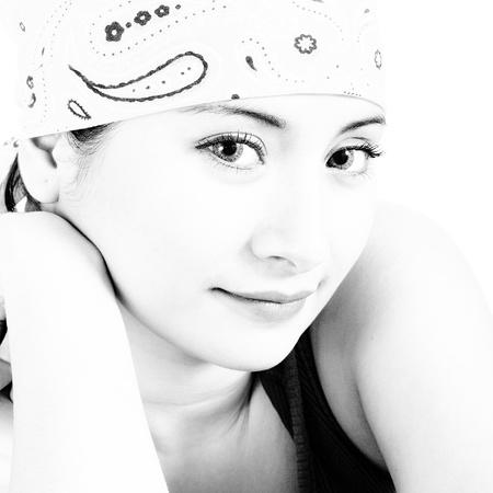 Beautiful Asian Girl Wearing A Yellow Head Bandana photo