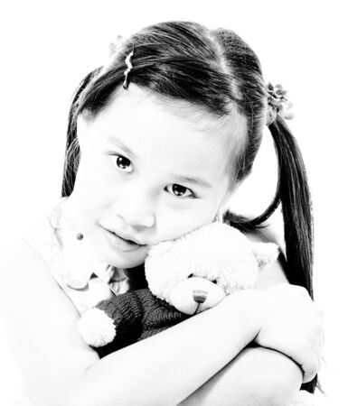 Young Cute Girl Hugging Her Small Teddy Bear photo
