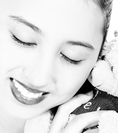 Pretty Teenager Cuddling Her Cute Teddy Bear Stock Photo - 12583974