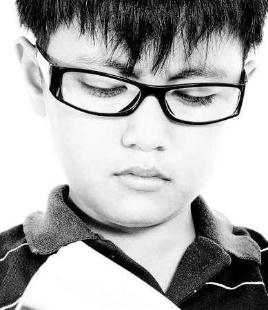 Child Improving His Education By Reading A Novel photo